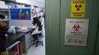 A researcher works in a lab that is developing testing for the COVID-19 coronavirus at Hackensack Meridian Health Center for Discovery and Innovation in Nutley, New Jersey on Feb. 28. Photographer: Kena Betancur/Getty Images