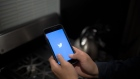 The Twitter Inc. logo is displayed on an Apple Inc. iPhone in this arranged photograph taken in the Brooklyn Borough of New York, U.S., on Monday, April 23, 2018. Twitter Inc. is scheduled to release earnings figure on April 25. Photographer: Alex FLynn/Bloomberg