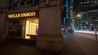 A Wells Fargo & Co. bank branch stands at night in New York, U.S., on Saturday, April 11, 2015.