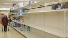 Empty shelves stand in the toilet paper aisle at a J Sainsbury Plc supermarket in Exeter, U.K. on March 6. Photographer: Luke MacGregor/Bloomberg