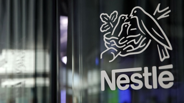 A bird's nest logo sits on display at the Nestle SA headquarters in Vevey, Switzerland, on Wednesday, Feb. 12, 2019. While Nestle's 2019 sales growth accelerated, analysts doubt the world's largest food company will achieve growth above 4% this year. Photographer: Stefan Wermuth/Bloomberg