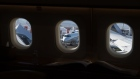 Planes are seen through the windows of an Airbus ACJ319neo private during the National Business Aviation Association Annual Convention in Henderson, Nevada, U.S., on Monday, Oct. 21, 2019.
