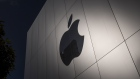 The Apple logo on a store in San Francisco. Photographer: David Paul Morris/Bloomberg