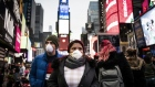 Pedestrians wearing protective masks walk through Times Square in New York yesterday. Click here for an exclusive look at the fierce fight that unfolded in the Oval Office ahead of Trump's virus speech and here for more of Bloomberg's most compelling political images from the past week. Photographer: Mark Kauzlarich/Bloomberg