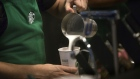 A barista pours frothed milk into a drink inside a Starbucks Corp. coffee shop in New York. Photographer: Victor J. Blue/Bloomberg