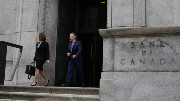 Stephen Poloz, governor of the Bank of Canada, right, and Carolyn Wilkins, senior deputy governor at the Bank of Canada, leave the Bank of Canada building on their way to a press conference at the National Press Theatre in Ottawa, Ontario, Canada, on Wednesday, April 24, 2019. A persistently sluggish global economy and a bleak outlook for the energy sector mean that interest rates won't need to rise as much as the Bank of Canada once thought, even if all economic headwinds eventually dissipate. Photographer: David Kawai/Bloomberg
