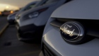 A Ford badge sits on a finished Kuga SUV automobile in a parking lot ahead of distribution at the Ford Espana SL plant, operated by Ford Motor Co., in Almusafes, Spain.