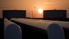 The sun rises beyond oil storage tanks at the Enbridge Inc. Cushing storage terminal in Cushing, Oklahoma, U.S.