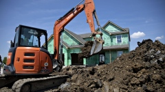 A worker operates a Hitachi Construction Machinery Co. excavator to dig a trench outside a new home under construction at a Lennar Corp. development in Montgomery, Illinois, U.S., on Wednesday, May 15, 2019. A stronger-than-expected increase in housing starts at the beginning of the second quarter bodes well for residential investment to make a contribution to GDP growth after five quarters of declines. Photographer: Daniel Acker/Bloomberg