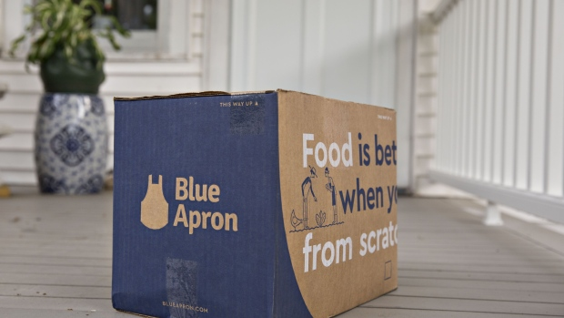 A Blue Apron meal-kit delivery package sits outside a home. Photographer: Daniel Acker/Bloomberg