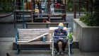An elderly person sits on a bench in the Chinatown neighborhood of San Francisco, California, U.S., on Tuesday, June 19, 2018. The Labor Department rule, aka the fiduciary rule conceived by the Obama administration, was meant to ensure that advisers put their clients' financial interests ahead of their own when recommending retirement investments has been killed by the Trump administration. Photographer: David Paul Morris/Bloomberg
