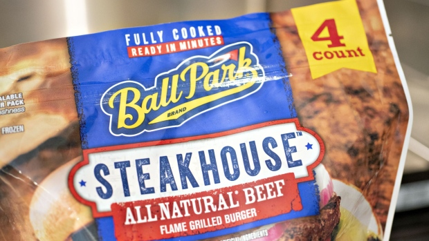 A package of Tyson Foods Inc. Ball Park brand steakhouse pre-cooked beef patties is arranged for a photograph in Tiskilwa, Illinois, U.S., on Monday, Aug. 6, 2018. The largest U.S. meat company posted better-than-expected fiscal third-quarter earnings as beef demand rose and cattle costs fell, Tyson said Monday in a statement. Photographer: Daniel Acker/Bloomberg