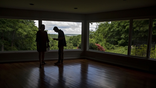 A real estate agent shows a prospective home buyer a house for sale in Peoria, Illinois, U.S., on Thursday, May 30, 2019. The National Association of Realtors is scheduled to release existing homes sales figures on June 21. Photographer: Daniel Acker/Bloomberg