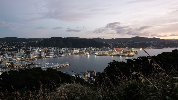 Residential and commercial buildings standing on the city skyline are seen from Mount Victoria Lookout at dawn in Wellington, New Zealand, on Saturday, June 22, 2019. The out-of-favor kiwi dollar has tumbled about 3% this quarter as the Reserve Bank of New Zealand turned dovish and cut interest rates, the first central bank in the developed world to do so. Economic growth held at a five-year low in the three-months through March, leaving the door open for further easing. Photographer: Birgit Krippner/Bloomberg