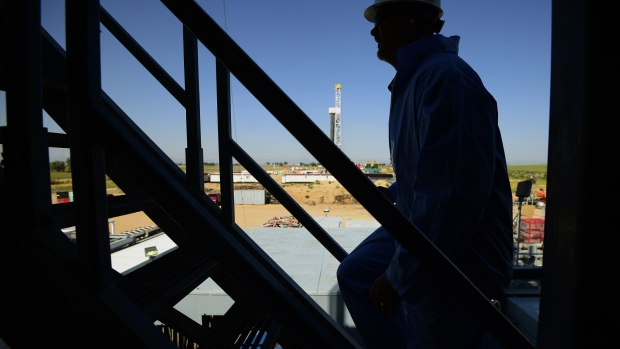 The silhouette of a contractor is seen walking up stairs at an Anadarko Petroleum Corp. oil rig site in Fort Lupton, Colorado, U.S., on Tuesday, Aug. 12, 2014. Photographer: Jamie Schwaberow