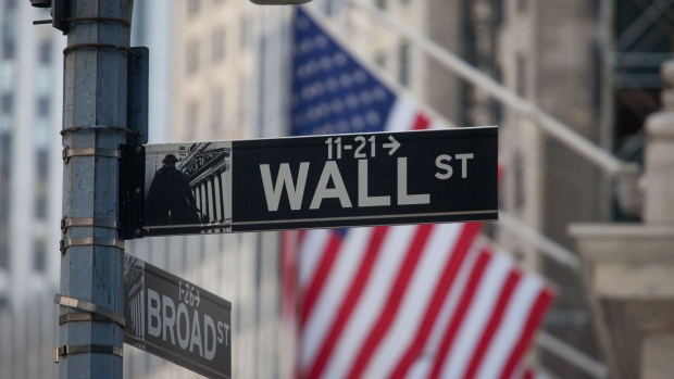 A Wall Street sign is displayed in front of the New York Stock Exchange (NYSE) in New York, U.S., on Friday, May 25, 2018.