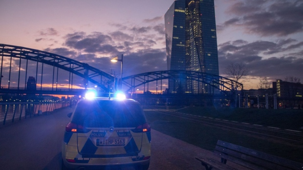 A police vehicle sounds it sirens during social distancing operations to control the spread of coronavirus near the European Central Bank (ECB) headquarters at night in Frankfurt, Germany, on Wednesday, March 18, 2020. Europe's bonds looked set for gains after the European Central Bank came to the rescue of debt markets for a second time this month with a 750 billion euro ($820 billion) quantitative easing package. Photographer: Alex Kraus/Bloomberg