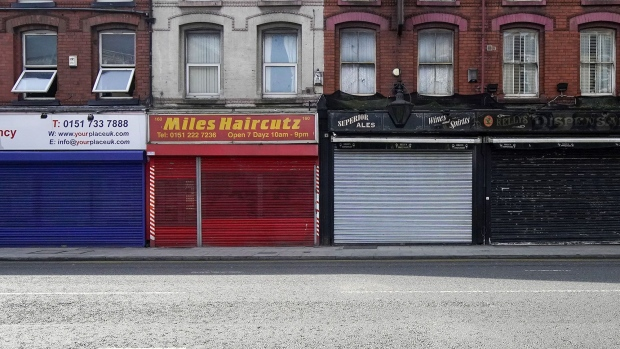LIVERPOOL, ENGLAND- MARCH 24: Shops are shuttered and closed as the UK begins strict lockdown measures to combat the pandemic on March 24, 2020 in Liverpool, England. British Prime Minister, Boris Johnson, announced strict lockdown measures urging people to stay at home and only leave the house for basic food shopping, exercise once a day and essential travel to and from work. The Coronavirus (COVID-19) pandemic has spread to at least 182 countries, claiming over 10,000 lives and infecting hundreds of thousands more. (Photo by Christopher Furlong/Getty Images)