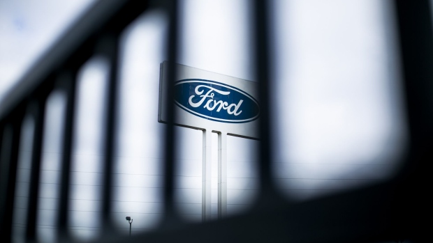 Signage is displayed outside the idled Ford Motor Co. Michigan Assembly plant in Wayne, Michigan, U.S., on Monday, March 23, 2020. The auto industry is escalating its push for U.S. assistance to help weather the impact of a global pandemic that has halted or will soon stop production at 42 out of 44 plants that assemble vehicles in the country. Photographer: Anthony Lanzilote/Bloomberg