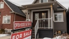 "A ""For Sale"" sign stands in front of a house in Toronto, Ontario, Canada, on Saturday, Feb. 15, 2020. A shrinking supply of available homes for sale in Canada's largest city continued to drive prices higher last month, bringing annual increases to the strongest in more than two years. Photographer: Brett Gundlock/Bloomberg"