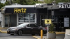 A vehicle exits from the Hertz Global Holdings Inc. rental location at LaGuardia Airport (LGA) in the Queens borough of New York, U.S., on Sunday, May, 6, 2018. Hertz Global Holdings Inc. is scheduled to release earnings figures on May 7. Photographer: Victor J. Blue/Bloomberg