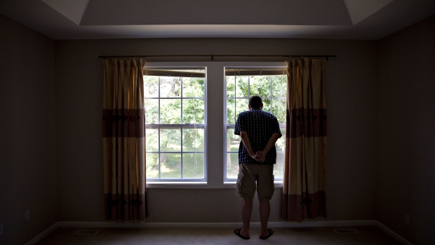 A prospective home buyer looks out the master bedroom window at a house for sale in Dunlap, Illinois, U.S., on Sunday, Aug. 19, 2018. The National Association of Realtors is scheduled to release existing homes sales figures on August 22. Photographer: Daniel Acker/Bloomberg