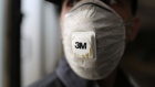 A workers wears a 3M Co. branded protective face mask during a deep-clean of GUP Mosgortrans passenger buses at a service terminal in Moscow, Russia, on Thursday, March 19, 2020.
