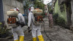 Workers disinfect a street surrounding a hospital in Niteroi, Brazil. Photographer: Dado Galdieri/Bloomberg