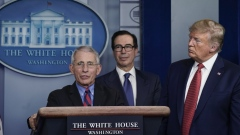 National Institute of Allergy and Infectious Diseases Director Anthony Fauci speaks as U.S. President Donald Trump and Treasury Secretary Steven Mnuchin look on during a briefing on the coronavirus pandemic at the White House on March 25, 2020.