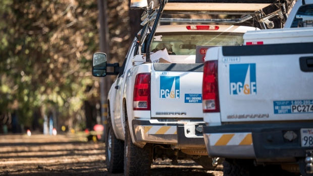 Pacific Gas & Electric Co. (PG&E) trucks sit on a roadside in Paradise, California, U.S., on Tuesday, Jan. 22, 2019. PG&E Co., California's biggest utility owner, faces $30 billion in potential wildfire liabilities, and its bankruptcy plan has reverberated across the power industry. The states big utilities have seen their shares plunge since November's deadly Camp Fire, and PG&E's debt rating has been cut to junk status. Photographer: David Paul Morris/Bloomberg