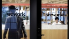 The WeWork logo is displayed on a glass door of the entrance to the WeWork Ocean Gate Minatomirai co-working office space, operated by The We Company, in Yokohama, Japan. Photographer: Kiyoshi Ota/Bloomberg