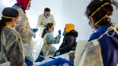 Doctors test people with flu-like symptoms for coronavirus in tents set-up to triage possible COVID-19 patients outside the main Emergency area at St. Barnabas hospital in the Bronx on March 24, 2020.