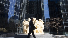 "A pedestrian walks past a sculpture on McGill College Avenue in Montreal, Quebec, Canada, on Friday, March 27, 2020. Quebec Premier Francois Legault said he's putting Quebec ""on pause"" to limit the coronavirus outbreak and stem physical contact. Photographer: Christinne Muschi/Bloomberg"