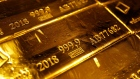 A mark of 999.9 fine sits on hallmarked 12.5 kilogram gold bullion bars stacked at the Valcambi SA precious metal refinery in Lugano, Switzerland, on Monday, April 24, 2018. Gold's haven qualities have come back in focus this year as President Donald Trumps administration picks a series of trade fights with friends and foes, and investors fret about equity market wobbles that started on Wall Street and echoed around the world. Photographer: Bloomberg/Bloomberg