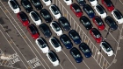 Vehicles sit parked outside of the Tesla Inc. assembly plant in this aerial photograph taken above Fremont, California, U.S.