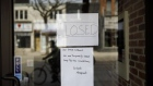 A closed sign is displayed on the door of a store on Queen St. in Toronto, Ontario, Canada, on Wednesday, March 25, 2020. The unemployment rate in Ontario, which accounts for almost 40% of Canada's output, was running at close to a record low before the province ordered all but essential businesses to shut down in a bid to contain the virus. Ontario now sees zero growth for this year. Photographer: Cole Burston/Bloomberg