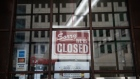"A ""closed"" sign hangs on the door of Lafayette Coney Island restaurant in Detroit, Michigan, U.S., on Saturday, April 4, 2020."