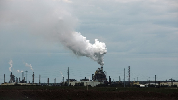 Steam rises from a Syncrude Canada Ltd. facility in the Athabasca oil sands north of Fort McMurray, Alberta, Canada, on Friday, June 14, 2019. Once the booming heart of the country's energy industry, the little city of 75,000 in northeastern Alberta has become a showcase for the debt troubles many Canadians are facing. Photographer: Amber Bracken/Bloomberg