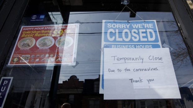 A closed sign is displayed on the door of a restaurant in Toronto on March 25.