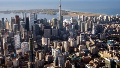 The CN Tower stands among buildings in the downtown skyline in this aerial photograph taken above Toronto. Photographer: James MacDonald/Bloomberg