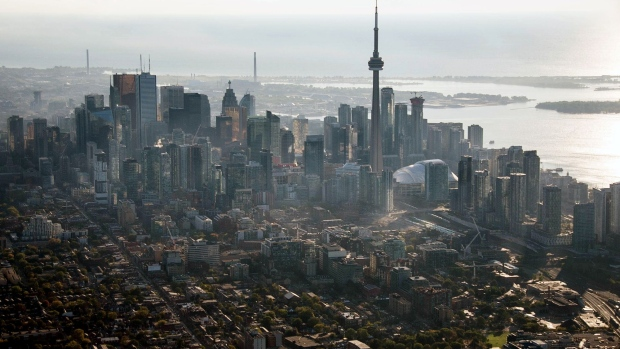 The CN Tower stands among buildings in the downtown skyline in this aerial photograph taken above Toronto, Ontario, Canada,