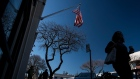 An American flag flies along Main Street in Los Altos, California, U.S., on Saturday, Feb. 8, 2020.
