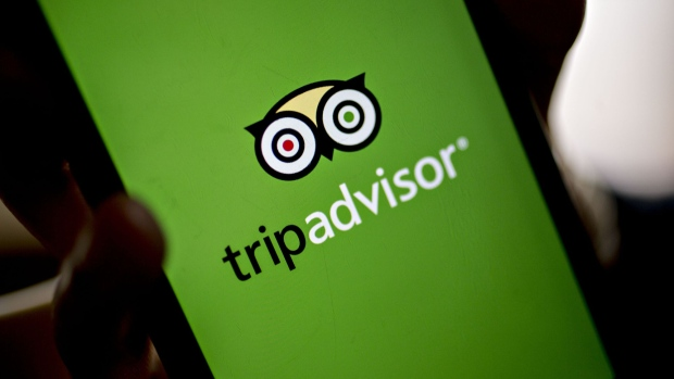 The TripAdvisor application on an iPhone. Photographer: Andrew Harrer/Bloomberg