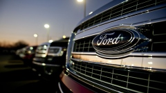 A Ford Motor Co. emblem appears on the grille of a 2014 F-150 pickup truck on display at Uftring Ford in East Peoria, Illinois, U.S., on Saturday, Nov. 30, 2013.