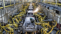 Sparks fly as Hyundai Corp. robotic arms weld panels of automobiles on the production line at the Kia Motors Slovakia plant in Zilina, Slovakia, on Monday, May 14, 2018. Kia's Zilina factory assembles Sportage SUVs as well as cee'd and Venga models. Last year it produced 335,600 vehicles and 539,987 engines. Photographer: Akos Stiller/Bloomberg