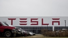 Vehicles sit parked outside the Tesla Inc. solar panel factory in Buffalo, New York, U.S., on Wednesday, Dec. 26, 2018. Employees at the factory this month kicked off a union-organizing campaign, a fresh challenge to the automaker that has so far successfully resisted similar efforts by the United Auto Workers at its sole car plant in Fremont, California. Photographer: Andrew Harrer/Bloomberg