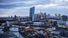The European Central Bank (ECB) headquarters, center, stand illuminated back dropped by the financial district skyline beyond shipping containers on the quayside at Frankfurt Osthafen container dock, operated by Contargo Rhein-Neckar GmbH, in Frankfurt, Germany, on Tuesday, Aug. 13. 2019. Germanys economy shrank in thesecond quarter, ramping up pressure on ChancellorAngela Merkelto unleash fiscal stimulus as manufacturers reel from a U.S.-China trade war. Photographer: Alex Kraus/Bloomberg