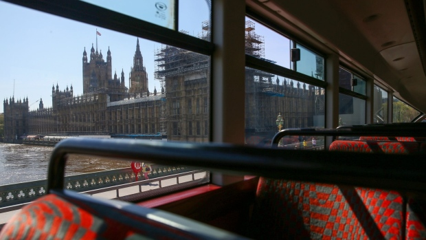 The Houses of Parliament stand in this view from inside a bus in London on April 22. Photographer: Hollie Adams/Bloomberg