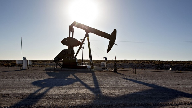 A pumpjack operates on an oil well in the Permian Basin near Orla, Texas. Photographer: Daniel Acker/Bloomberg