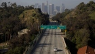 A vehicle drives along the nearly empty 110 freeway in Los Angeles, California, U.S., on Wednesday, April 1, 2020. The U.S. West Coast is offering hopeful signs that early social distancing efforts worked, allowing officials to increase hospital capacity and slowing the spread of the novel coronavirus. Photographer: Patrick T. Fallon/Bloomberg